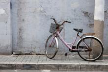 Old Bicycle On Village Street
