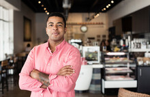 Portrait Of Young Man In Coffee Shop