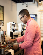 Coffee Shop Barista Removing Coffee Grounds