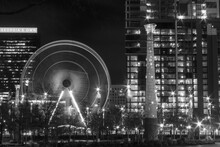 Black And White City Skyline Ate Night With Ferris Wheel