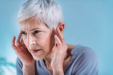 Senior Woman Suffering From Tinnitus