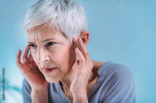 Billede på lærred Senior Woman Suffering From Tinnitus