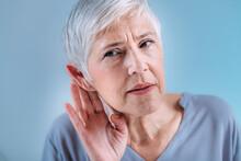 Hearing Loss. Senior Woman With Symptoms Of Hearing Loss.