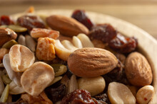 An Extreme Closeup View Of A Wood Bowl Of Trail Mix.