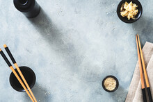 Blue Empty Food Background With Sushi And Asian Food Theme And Concept. Chopstick