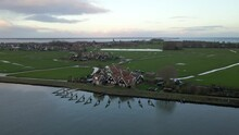 Old Traditional Community In Rural Landscape Of Holland With Breakwaters