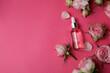 Leinwandbild Motiv Skin care concept with essential rose oil on pink background