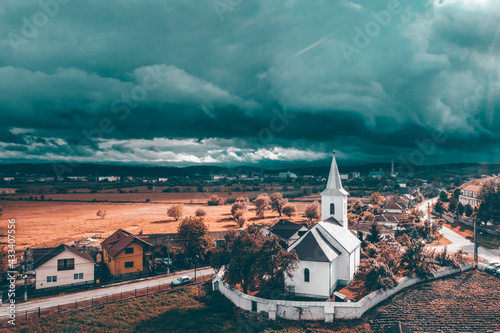 Foto Church beafore storm in Transylvania.