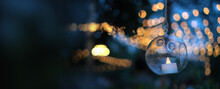 Beautiful Evening Garden Party Glass Ornaments With Candle Bokeh Festive Light Background