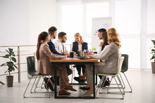 Businesspeople Having Meeting In Office. Management Consulting