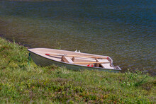 One White Boat In The Grass.