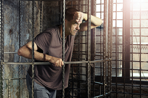 Man criminal  in cage, prison Fototapet