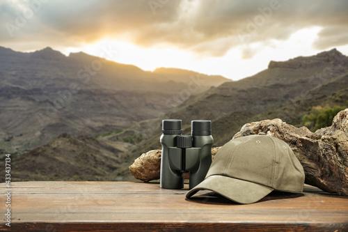 Fotografia Binoculars on desk and summer landscape of free space