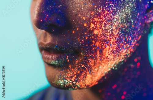 Handsome boy dancing at the rave party with fluorescent paintings on his face Fototapet