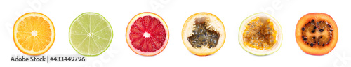 Fotografering Set with different delicious cut exotic fruits on white background