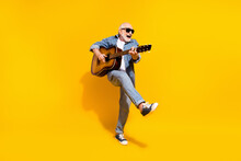 Full Length Photo Of Cool Happy Positive Old Man Dance Hold Guitar Wear Sunglass Isolated On Yellow Color Background