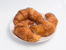 3 Croissants On A White Plate