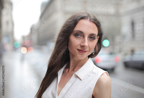 portrait of a young woman in the street