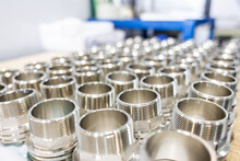 Many Metal Pipe Couplings In A Pipe Factory