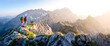 Leinwandbild Motiv two hikers with dog in the mountains