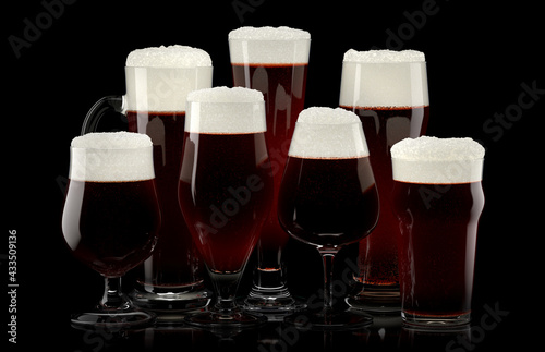 Obraz Set of fresh draft beer glasses with bubble froth isolated on black background. - fototapety do salonu