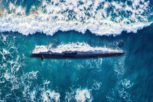 Combat Military Nuclear Diesel Electric Submarine On Background Of Blue Ocean Water. Top View Aerial Drone
