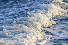 Seawater Churned To A Froth In The Wake Of A Large Ship. Late Afternoon Golden Light.
