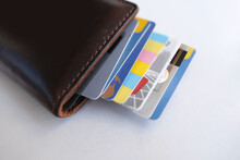 Close-up Of Payment Credit Cards In A Stack In A Leather Wallet On A White Table, The Concept Of Electronic Payment, Payments From Bank Funds, Credit History, Business