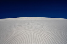 Bright White Sand Dunes With Deep Blue Sky