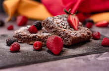 Fruit Brownie Garnished With Strawberries And Cherries