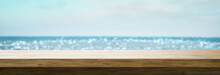 Empty Table On A Defocused Beach Background - Copy Space