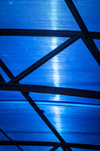 Blue Polycarbonate Canopy In The Backyard Of A Private House.