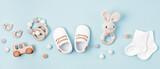 Fototapeta Kawa jest smaczna - Baby shoes and teethers banner. Organic newborn accessories, branding, small business idea.
