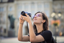 Young Woman Taking Photo In The City With Camera. Great Photo.