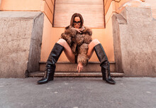 Female Fashion Model Sitting On Stairs On The Street