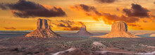 Beautiful Dramatic Sunset Over The East, West Mitten Butte And Merrick Butte In Monument Valley. Utah, USA. Panoramic Photo
