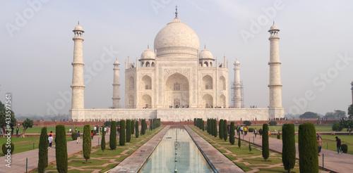 Fotografie, Obraz Taj Mahal ivory-white marble mausoleum on the south bank of Yamuna river in Agra