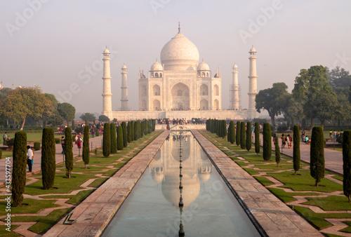 Fototapeta Taj Mahal ivory-white marble mausoleum on the south bank of Yamuna river in Agra