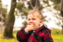 Adorable Baby Boy Crying In A Park