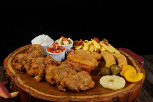 Cuban Filet. Made With Breaded Steak, Banana, Breaded Cheese And Ham, French Fries With Bacon. Accompanies Red Tomato Vinaigrette, Select Vegetables, White Rice, Peach Pineapple And Fig.