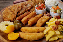 Tasty Cuban Filet. Made With Breaded Steak, Cheese, Breaded Ham And Banana, Vinaigrette, White Rice, Pineapple And Fig. Gastronomy Photo Of Dishes That Accompany Fruit And Breaded.