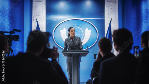Canvas-taulu Organization Female Representative Speaking at Press Conference in Government Building