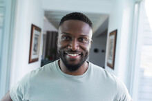 Portrait Of African American Man Looking At Camera And Smiling