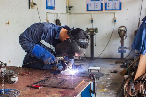 Fototapeta Welding male worker metal is part