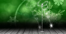 Vintage Microphone On A Stand Over Green Snowflakes Background, Performance And Holiday Concepts