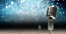 Vintage Microphone On A Stand Over Blue Sparkling Background, Performance And Holiday Concepts