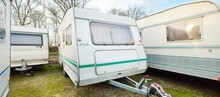 Caravan Trailers Parked On A Green Lawn. Winter. Local Business, Company, Service Concept. Netherlands. RV, Motorhome, Transportation, Road Trip, Traveling, Ecotourism, Lifestyle, Comfort