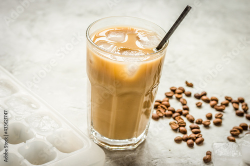 Obraz Ice coffee with milk and beans for lunch on stone background - fototapety do salonu