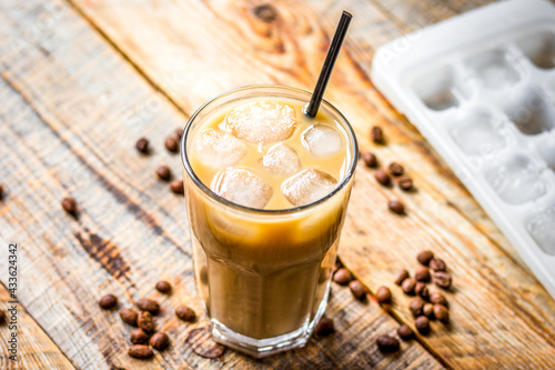 Obraz iced coffee with beans for cold summer drink on wooden background - fototapety do salonu