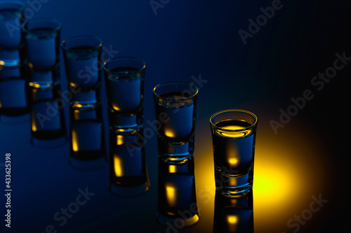 Obraz Strong alcoholic drink in color bright lights. - fototapety do salonu